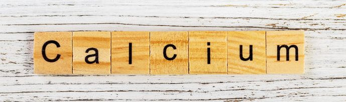 calcium word made with wooden blocks concept