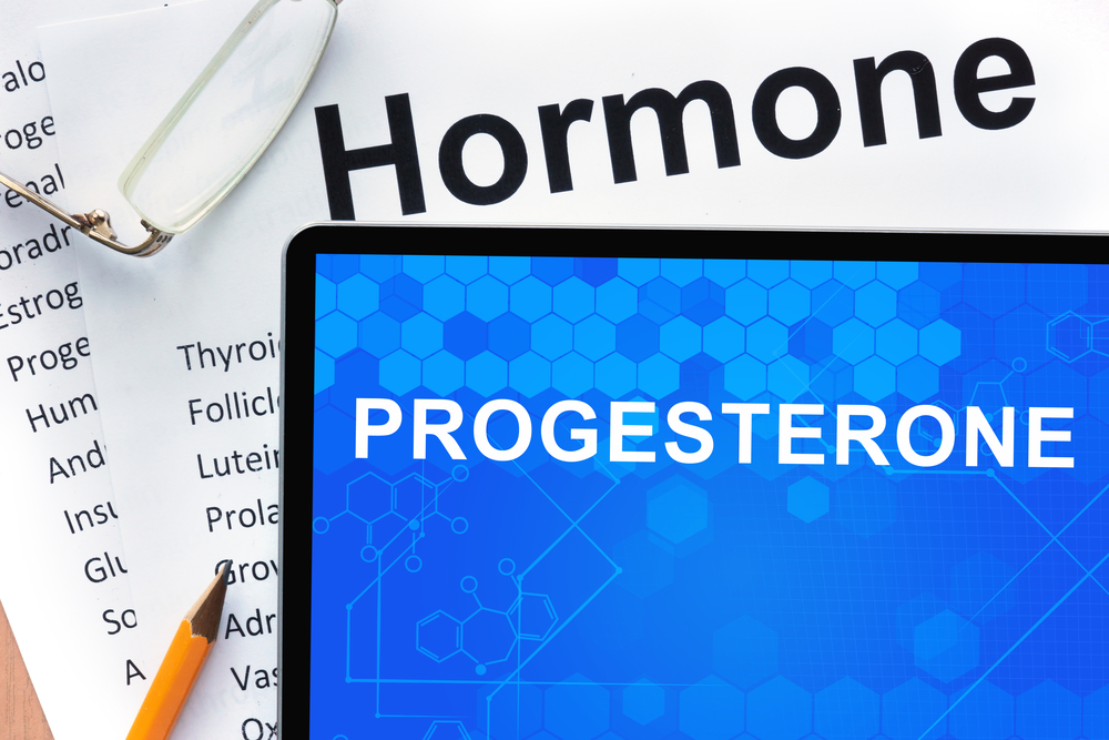 progesterone and hormone text displayed on desk
